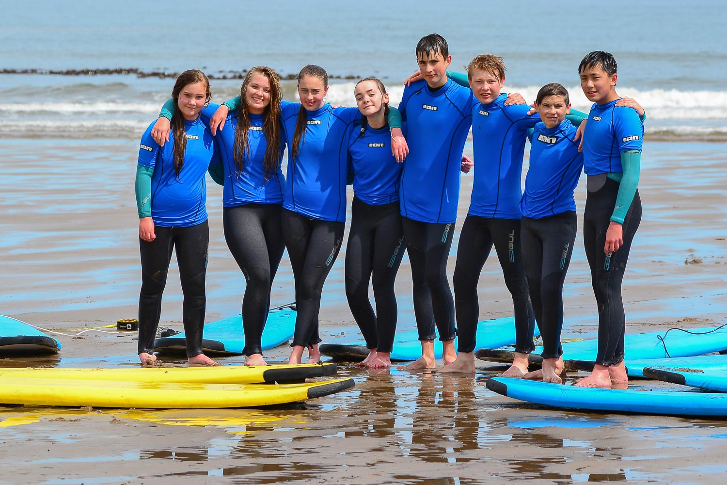 Teenagers enjoying a Group Surf Lesson