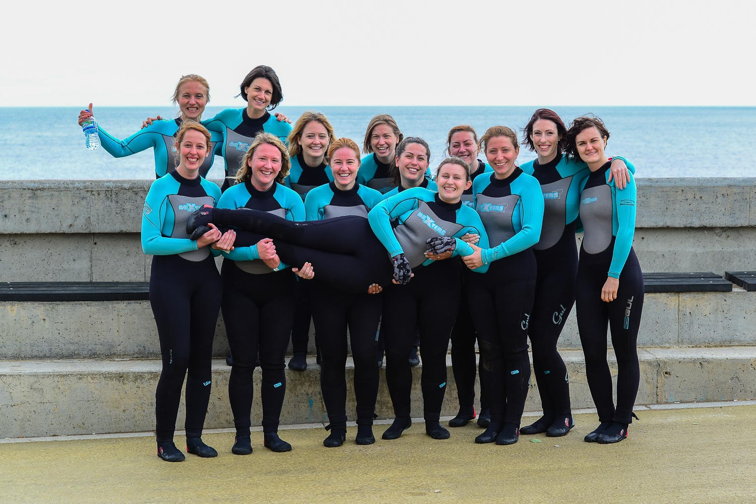 Hen party group photo, holding the bride!